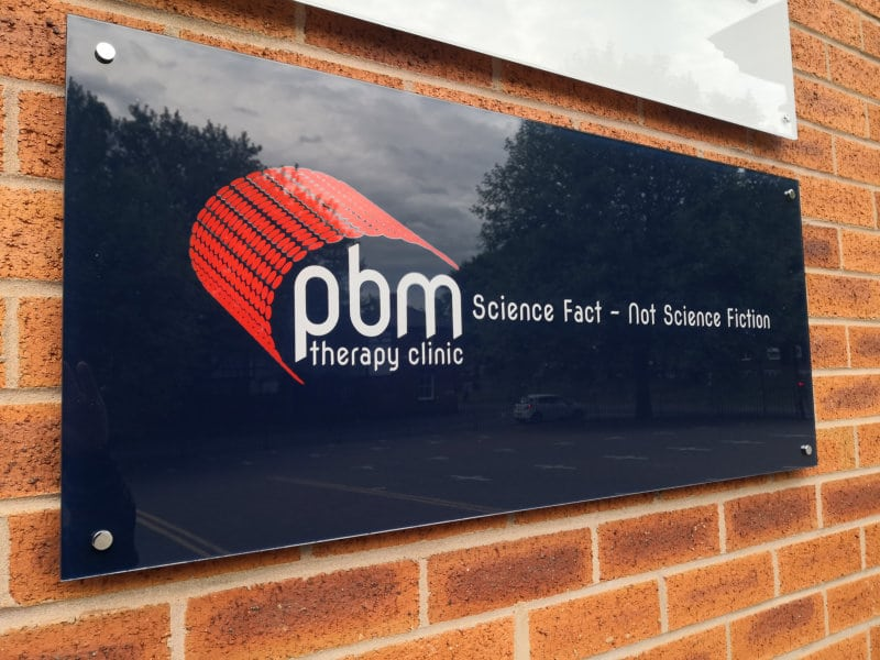 External PBM Therapy Clinic sign close up view
